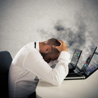 Businessman with worried expression with computers in smoke, Image: 300927577, License: Royalty-free, Restrictions: , Model Release: yes, Credit line: Profimedia, Stock Budget
